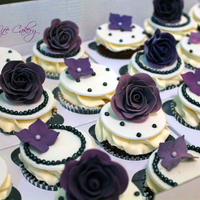 Shades Of Purple Chocolate and white velvet cupcakes with purple gum paste roses and hydrangea