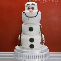 Sculpted Olaf Cake Chocolate and vanilla cake with fondant accents.