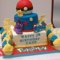 Pokemon Birthday Cake Three tier fondant covered cake. Tiers are vanilla pound cake and red velvet. Pokemon characters (Pikachu, Seviper and Arbok) are gumpaste...