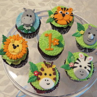 Jungle Cupcakes! Jungle animal toppers to go with my Jungle cake for my granddaughter's first birthday! Toppers are made from fondant! Thank you for...