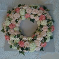 "Bridal Wreath this is a 5 1/2 dz. mini cupcake flower wreath that was made for a bridal show this weekend as a display. 14"" foam wreath used as my..."