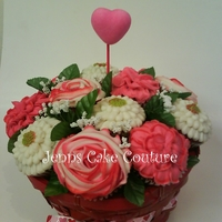 Valentines 1 dz. regular size cupcakes (Red Velvet). Early Val. order for customer taking to Flagstaff, AZ (Im in CA). TFL Silk leaves...