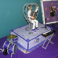 Justin Bieber Birthday Cake strawberry cake with white chocolate buttercream, deco is Justin Bieber toys.