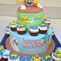 Super Mario Super Mario with matching cuppies. Gumpaste, fondant and chocolate ganache.