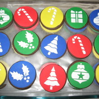 Christmas Cookies These are chocolate sugar cookies with fondant disks and stenciled with royal.