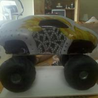 Monster Truck strawberry cake with buttercream frosting covered with mmf