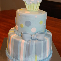 Boys First Birthday Cupcake Cake Buttercream with fondant accents. Cupcake is made from gumpaste.