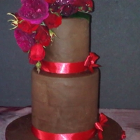 Chocolate Double Tier With Real Flowers Double barrel two tier wedding cake with dark chocolate ganache, chocolate fondant with real david austin roses