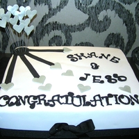 Black And Silver Engagement Slab Chocolate buttermilk with dark chocolate ganache and covered in fondant
