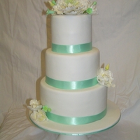 3 Tiers With Sugar Flowers 3 tiers, fondant covers, sugar peonies with luster dusk for a garden wedding