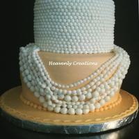 Drenched In Pearls Cake made for a lady who wanted pale orange and light ivory colors. She said she wanted something elegant and this is what I made for her....
