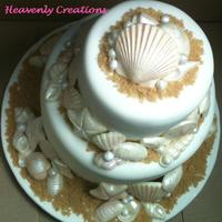 She Sells Sea Shells By The Sea Shore Shell cake made for an all white birthday party. I really like this cake. I would love to make it as a wedding cake.
