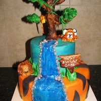 Jungle Safari Cake All edible. Buttercream with fondant accents and fondant tree hand painted.