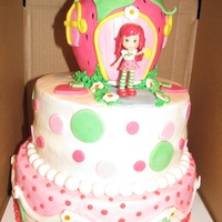 Strawberry Shortcake covered in bc. strawberry made of rkt and covered in fondant. all decorations made of fondant