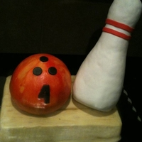 Bowling iced in bc. bowling ball is cake covered in bc. pin is rkt covered in fondant