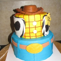 Woody Toy Story Cake Covered in buttercream with fondant accents including fondant hat
