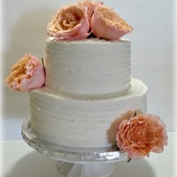 Shabby Chic Wedding Cake   A textured buttercream iced wedding cake with fresh roses.