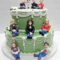A Happy 70Th Birthday A buttercream iced cake with gumpaste figures. Eight grandchildren for Grandma's 70th birthday.