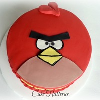 "An Angry Bird For Thomas 8"" vanilla cake, filled with vanilla bc icing, and covered with fondant and fondant details. The outline around the eyes and mouth..."