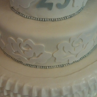 White And Silver 3 tiers, white and yellow cake with buttercream frosting. All fondant and gumpaste decorations!