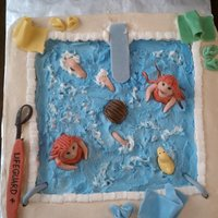 Swimmimg Pool Cake for the last day of swimming class. Buttercream with homemade fondant figures and accessories.