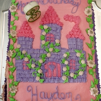 Hayden's Princess Castle Cake Butter cream icing with royal icing flowers