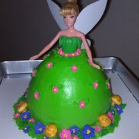 Tinkerbell Birthday Cake With Buttercream Icing Royal Icing Flowers And Fondant Mushrooms Tinkerbell birthday cake with buttercream icing, royal icing flowers and fondant mushrooms.