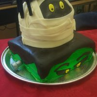 Mummy And Frankie Halloween Cake. Frankie is chocolate with choc bavarian creme covered in green crusting buttercream icing. Mummy is vanilla with...