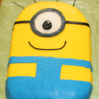 Despicable Me Minion Cake  This is just a simple cake done in buttercream. It's nothing spectacular but I thought I'd share it in case someone was looking...