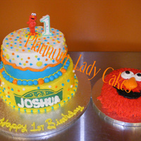1St Birthday Elmo Theme This cake was for a little one that loves Elmo. The Elmo on top of the cake doubled as a spoon. I got the idea from a couple cakes on here...