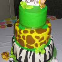 Jungle Baby Shower!  Three tiered white, strawberry, and red velvet cake with buttercream icing and fondant accents. Animals were plastic (didn't have time...