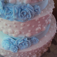 Wedding Bliss Three tiers, buttercream icing, buttercream roses, fondant ribbon