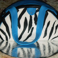 First Attempt At A Purse Cake I went to a new cake decorating place by where I live, they have classes twice a week. This is what I made this first time. A zebra cake...