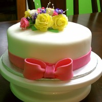 Just Simple red velvet and cream chesse frosting covered in mmf and flowers and ribbon also mmf