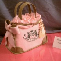Juicy Purse Birthday Cake This was a lot of fun to make. It's orange 50/50 bar with vanilla buttercream. The handles and heart chain were made from gumpaste....