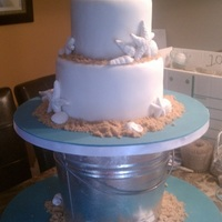 Seashell Wedding Cake Had to assemble at this at the reception site (which just happened to be the bride's house) the day of because of the bucket. Had fun...