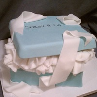 Tiffany Box   White cake with vanilla buttercream filling. The top is made from gumpaste :) Charged $80 for this cake. TFL!