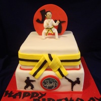 "Karate Birthday Cake 10"" bottom chocolate with raspberry buttercream and an 8"" top tier, white also with raspberry buttercream. I charged $155 for..."