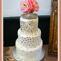 Gold Polka Dot Cake With Teacup Topper. Fondant covered cake with gold polka dots. Painted with gold highlighter dust.