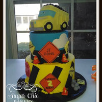 Construction Cake Buttercream with fondant accents. The cartoon dumptruck in rice crispy treats covered in fondant.
