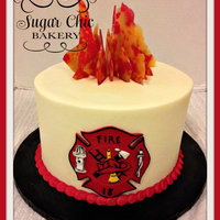 "Fire Fighter Birthday Cake This is an 8"" butter cream cake with a fondant symbol and candy flames."
