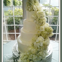 4 Tier Buttercream Cake Flowers sure make a plain white cake grand!