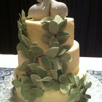Friends Wedding Cake - Butter Cream With Gumpaste Leaves  This was my first attempt at doing strictly buttercream ... need to practice a bit more. Was very happy with the gumpaste leaves.The cake...