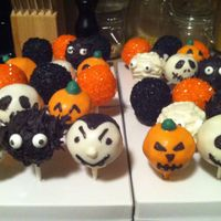 Halloween Cake Pops   These were made for my sister's birthday as per her request. Carrot cake w cream cheese icing.