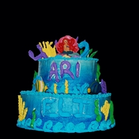 Ariel & Fish Bday  Cake for my 4 year old daughter & 2 year old son't combined bday. royal icing coral, fish & ariel candles on a 2 tiered cake...