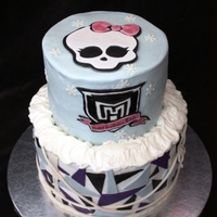 Monster High Cake... Abbey Bomniable 2-tier cake... both chocolate filled with chocolate ganache. Buttercream backgrounds with fondant accents. Skull logo cut using template,...