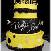 Baylee Bee 1St Birthday Bumble Bee themed cake - Bottom tier red velvet with cream cheese filling - Middle tier chocolate with BC filling - Top (smach cake) French...