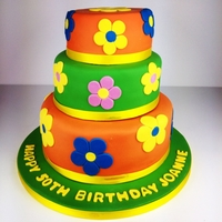 1960S Flower Power Birthday Cake 3 tier fondant covered cake with bright 1960s style floral design