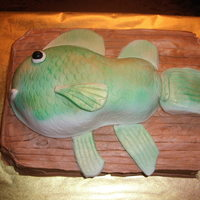 Fish Cake Carrot Cake with cream cheese icing for the board. RKT for the fish body covered with homemade fondant. Should have done something...