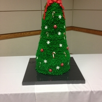 7 Tiered 3D Christmas Tree Cake 7 Tiered 3D Christmas Tree - fondant bow topper, snowflakes and candy canes. Buttercream pulled stars for tree. Cake balls used as...